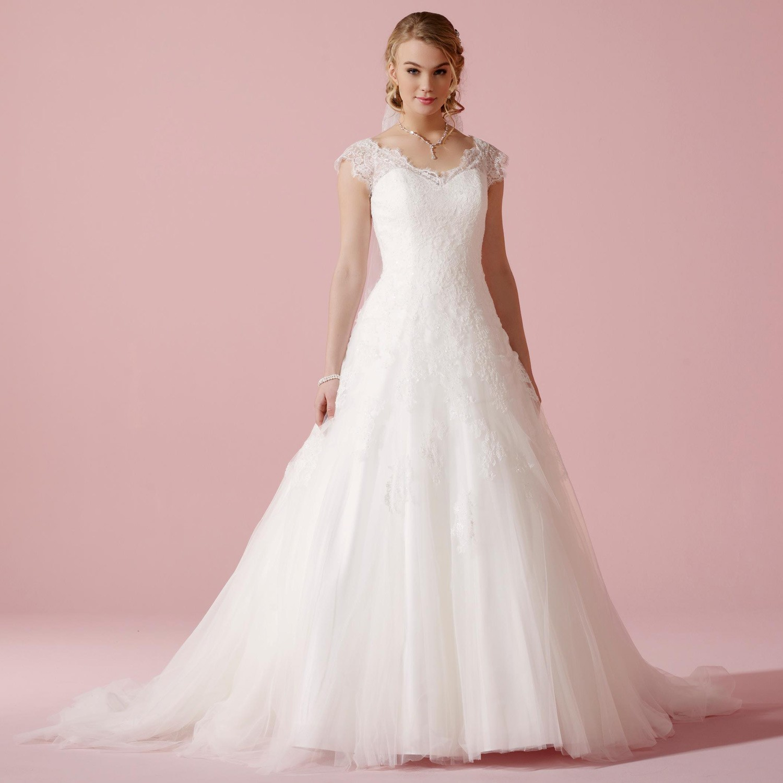 Une joyeuse mariée dans sa robe